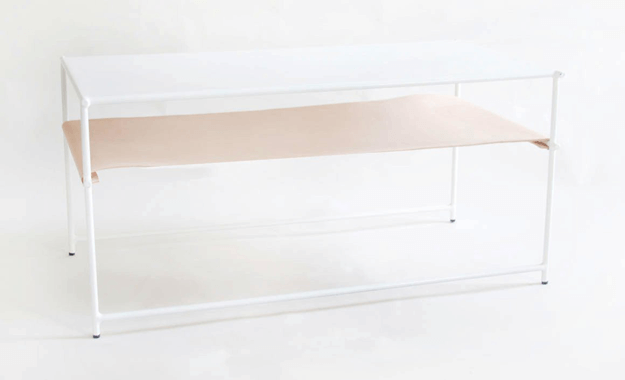 white modern coffee table with pantone hazelnut shelf
