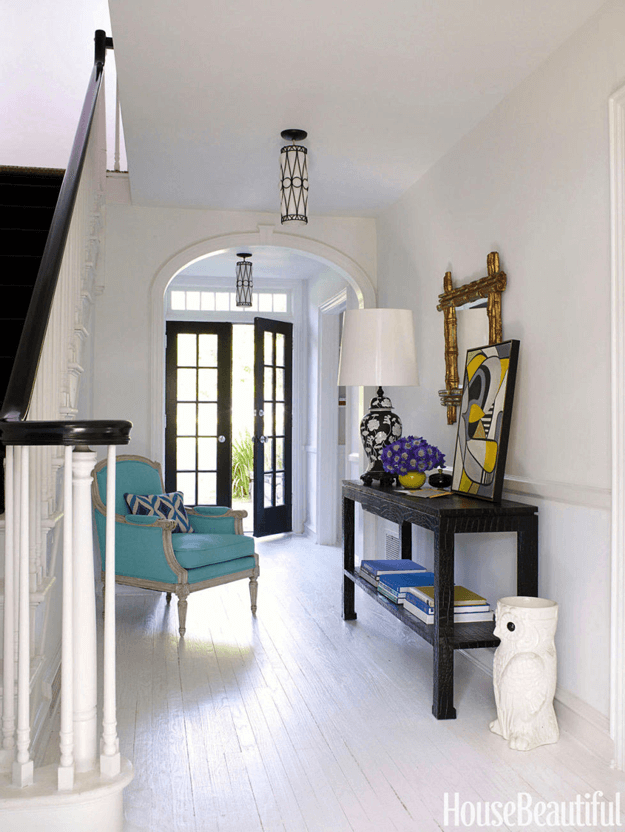 white foyer with turquoise blue chair