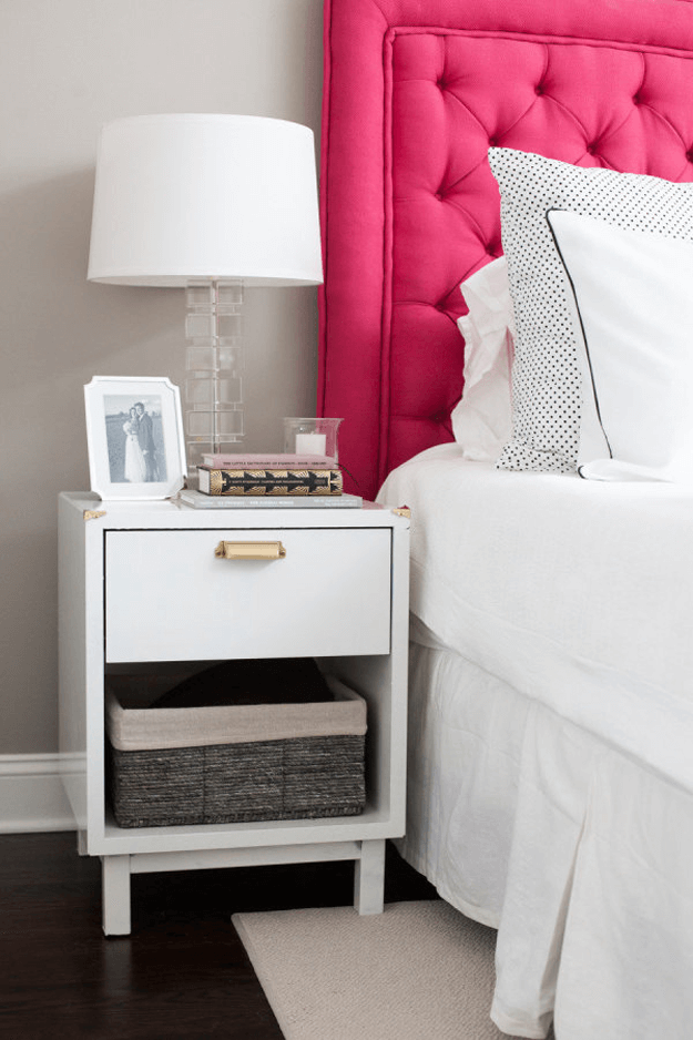 gray and white bedroom with hot pink headboard