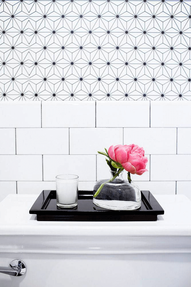 black and white bathroom with hot pink accent