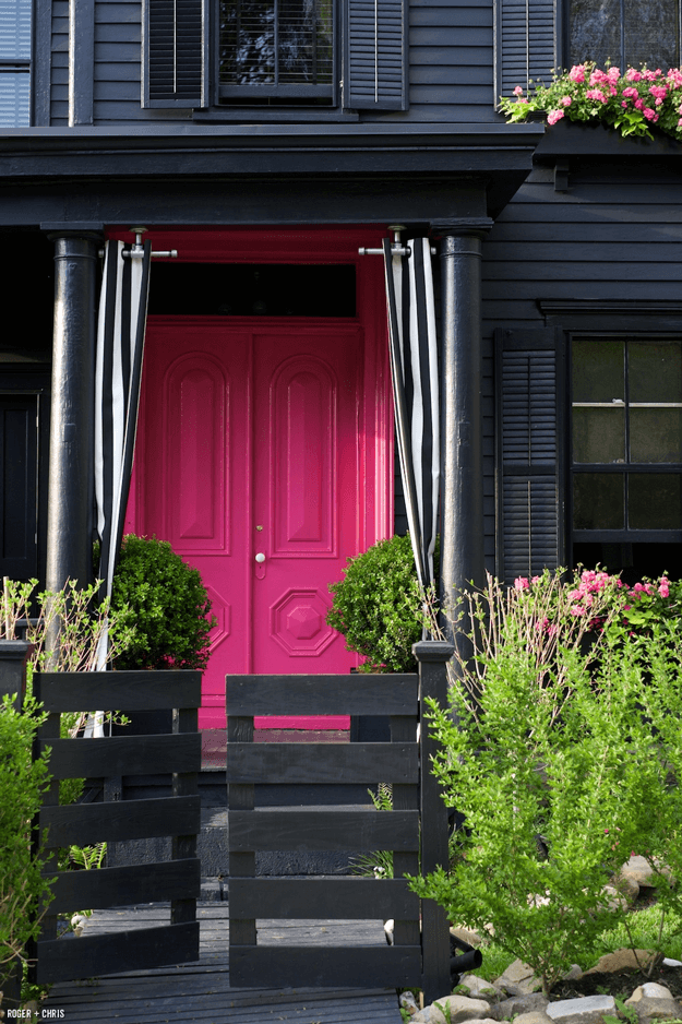 black home exterior with fuchsia pink doors