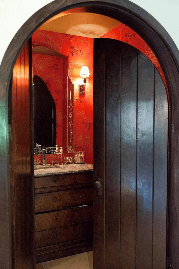 bright red bathroom with dark wood door