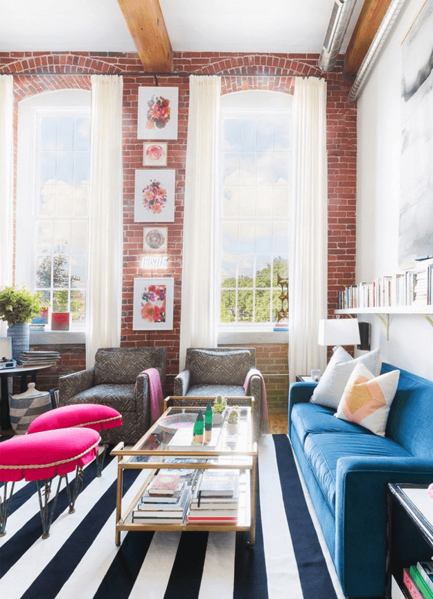 eclectic living room with hot pink stools