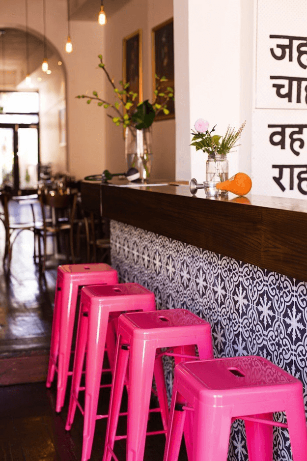 indian canteen restaurant interior with hot pink stools
