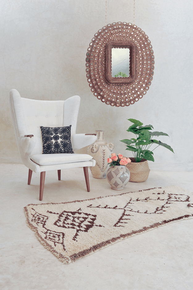 living room with light brown moroccan tribal rug