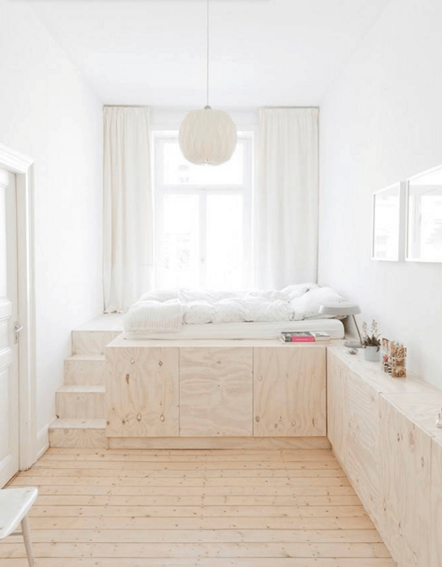 minimal white bedroom with plywood built-ins