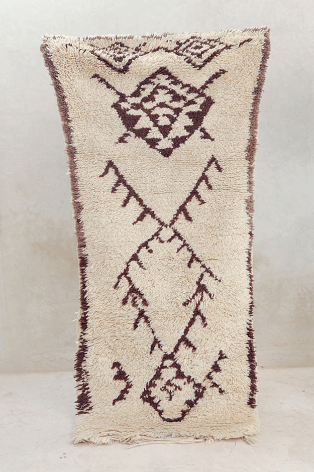 pale brown tribal vintage rug