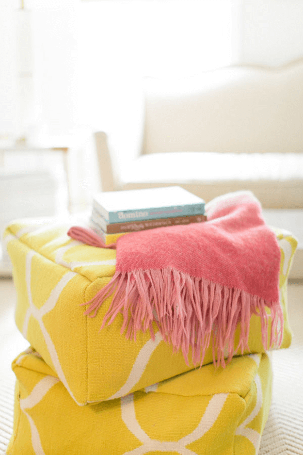 creamy white living room yellow coral pink accents