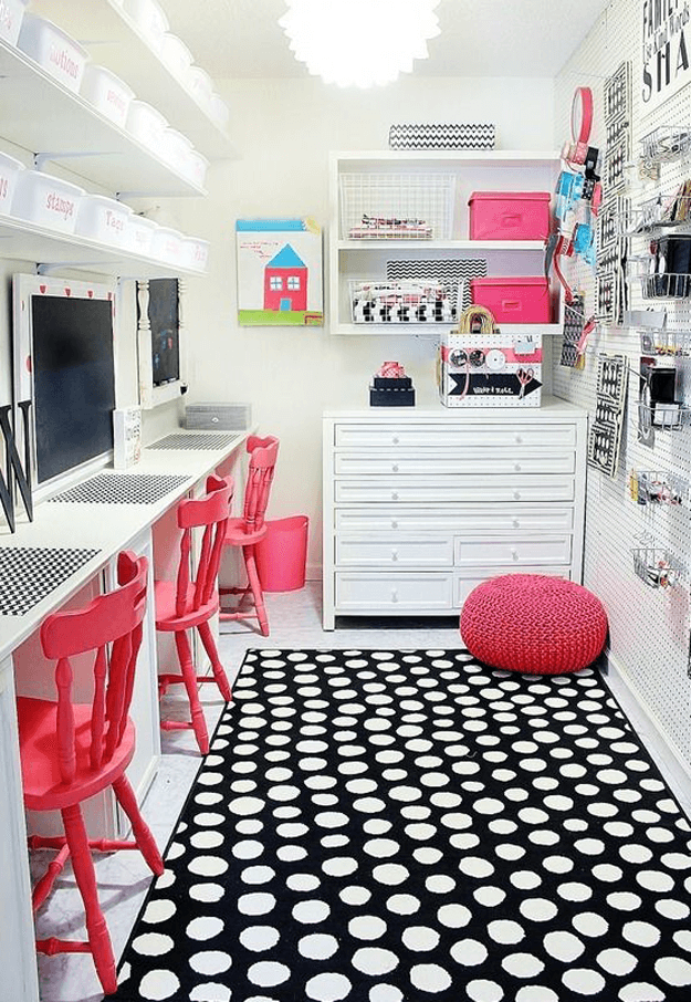 black and white craft room with pink accents