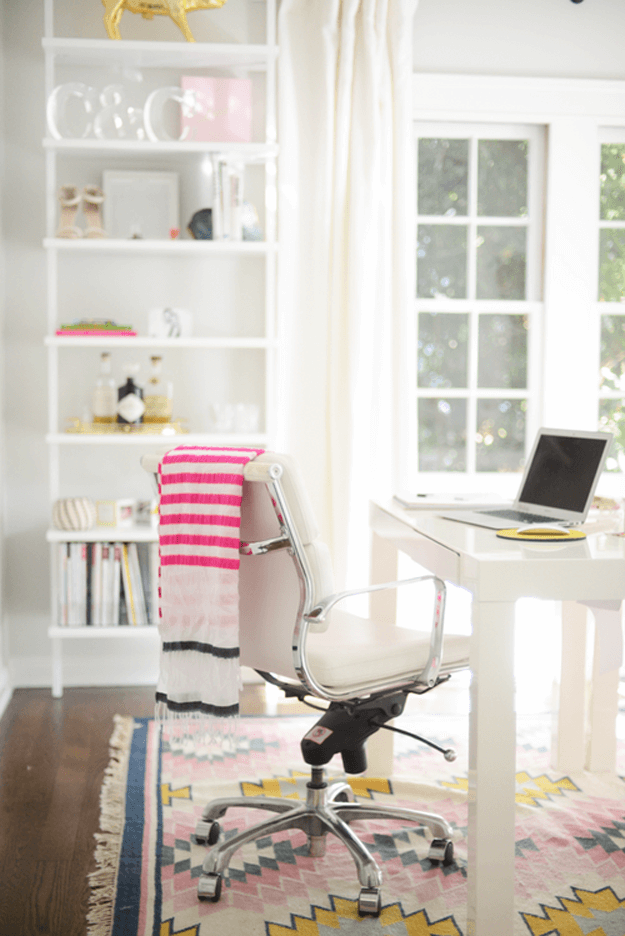 white home office with hot pink accents