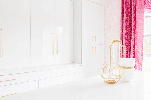 white kitchen with fuchsia curtains