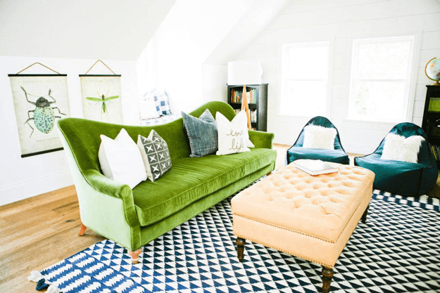 eclectic living room with moss green sofa