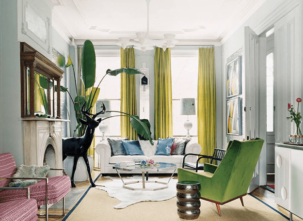 eclectic living room with moss green modern chair