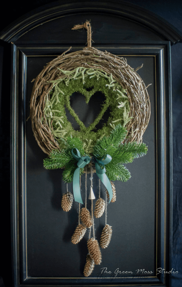 green moss wreath on black door