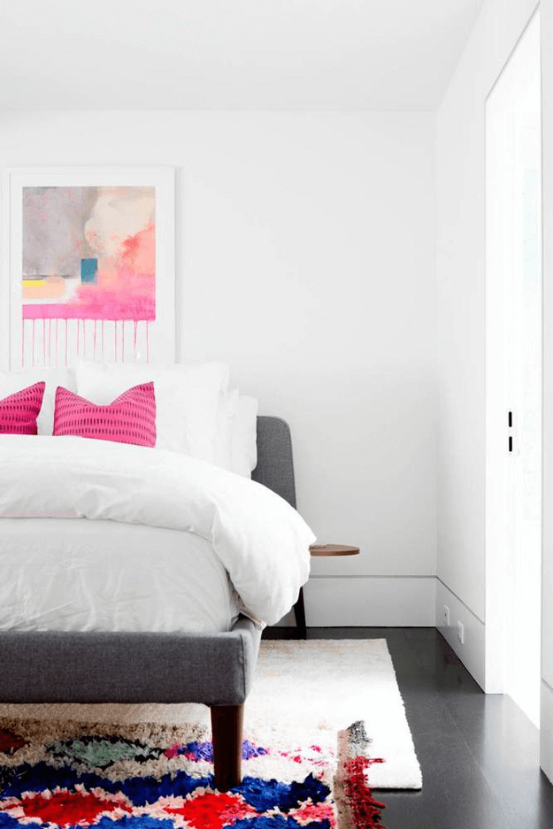 white bedroom with fuchsia accents