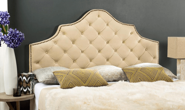 beige upholstered tufted headboard
