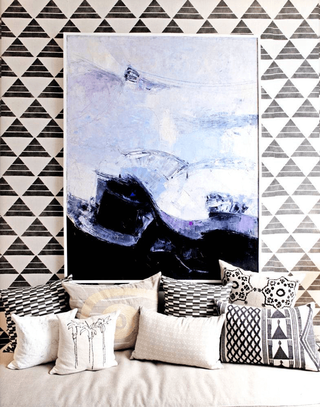black and white graphic interior design with periwinkle accents