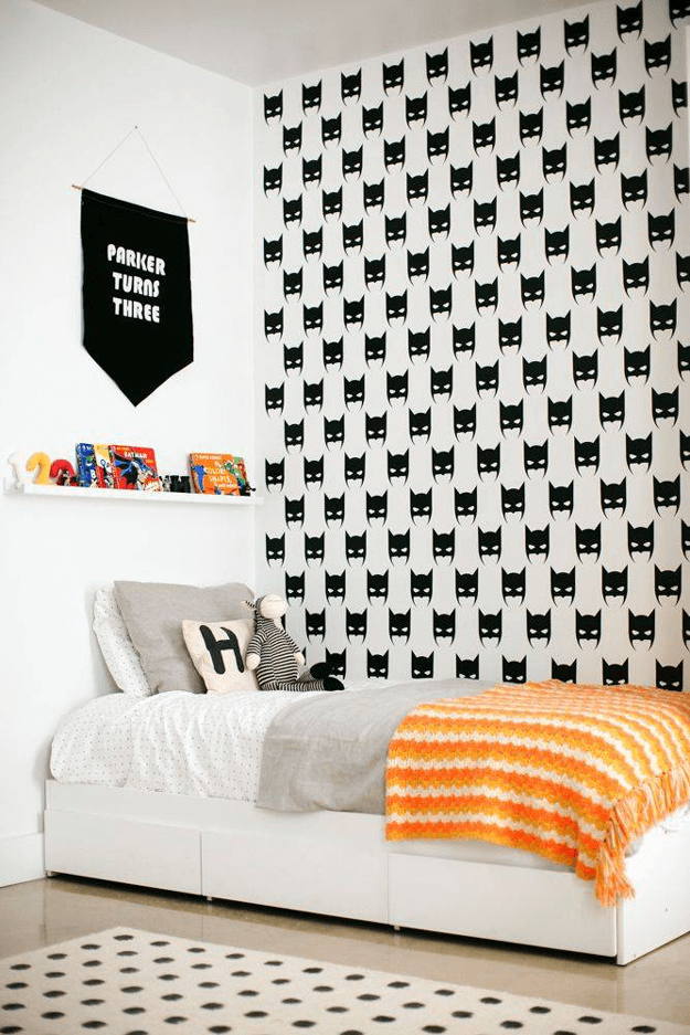 white bedroom with batman wallpaper accent wall