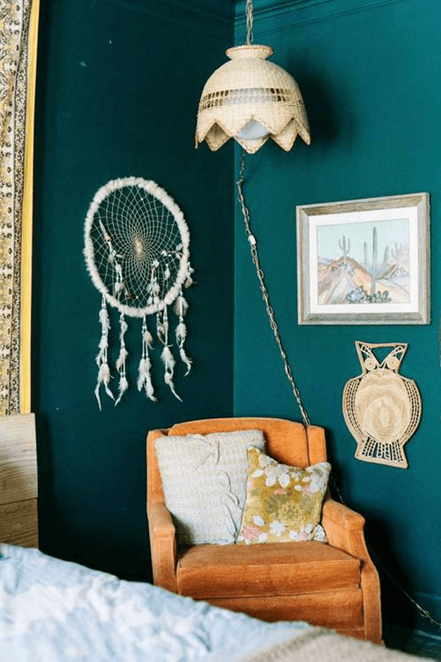 dark teal green room with burnt orange chair
