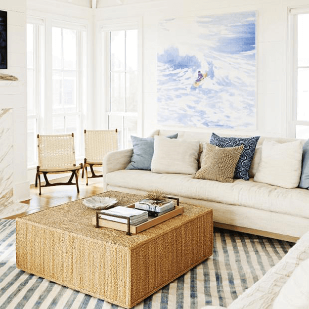 creamy white coastal style living room with periwinkle accents