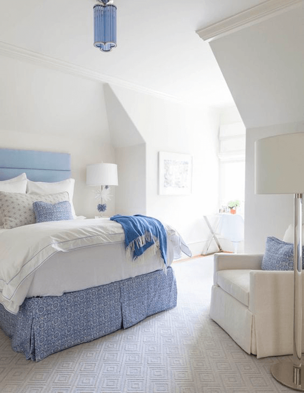creamy white bedroom with periwinkle blue accents