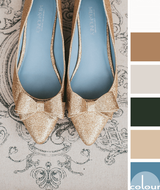 gold flats with slate blue interior on taupe background