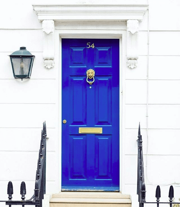bright blue door in white wall