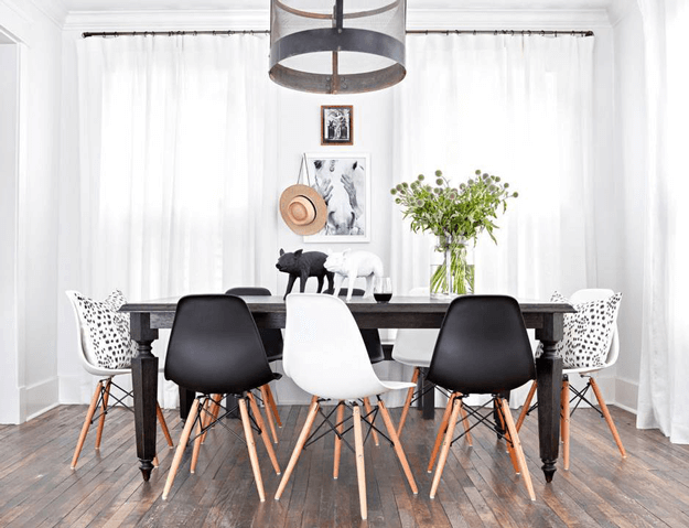 Modern Dining Room With Black And White Eames Chairs