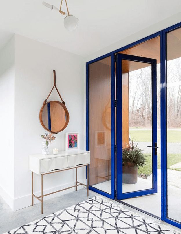 white modern home entry with bright blue entry