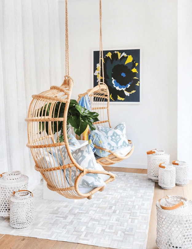 hanging swing chairs in white room