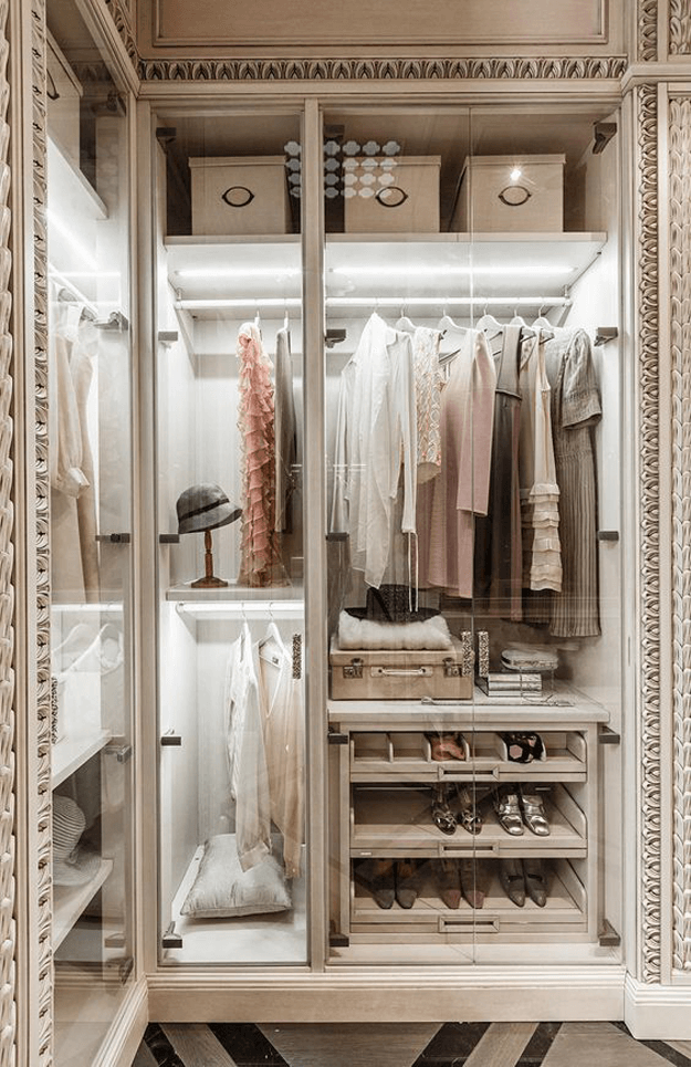 neoclassical closet design with cove lighting