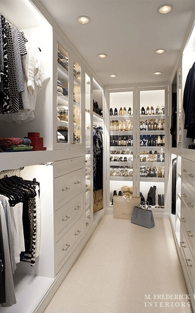 white walk in closet with cove lighting