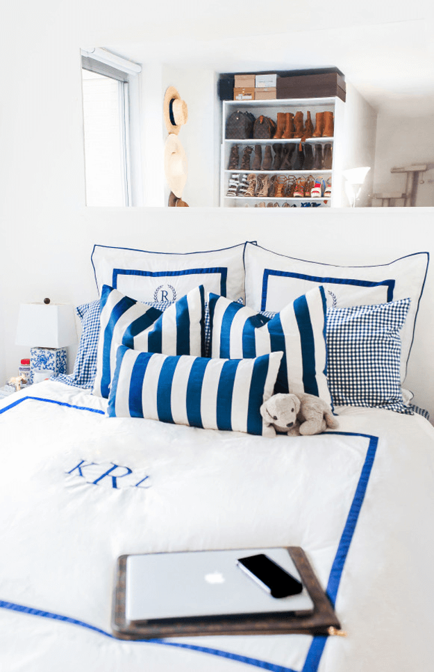 white bedroom with bright blue striped bedding