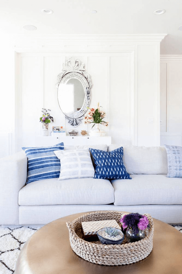 dreamy white living room lapis blue accents