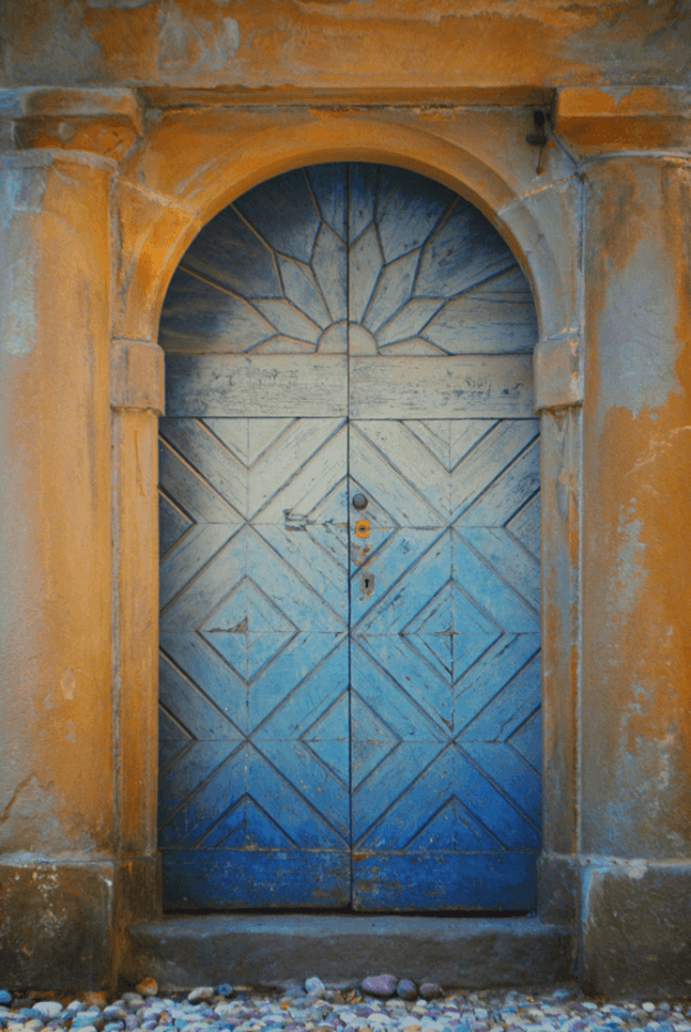 faded blue italian door in rust orange wall