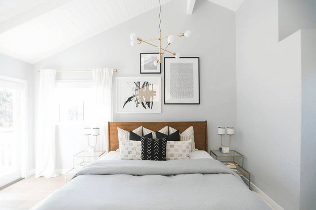 pale gray bedroom with light taupe wood floors