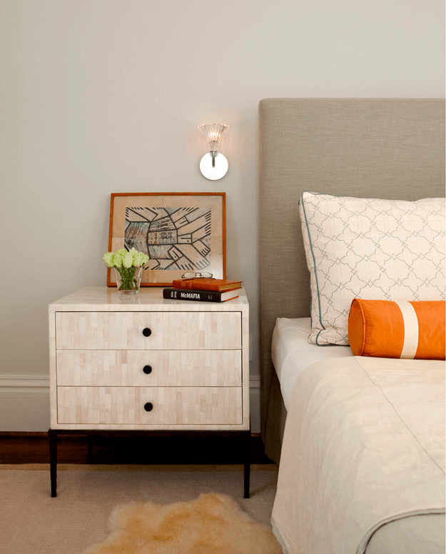 light taupe bedroom with burnt orange accent