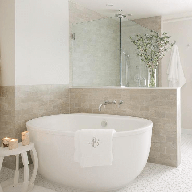 light taupe bathroom with white modern freestanding tub