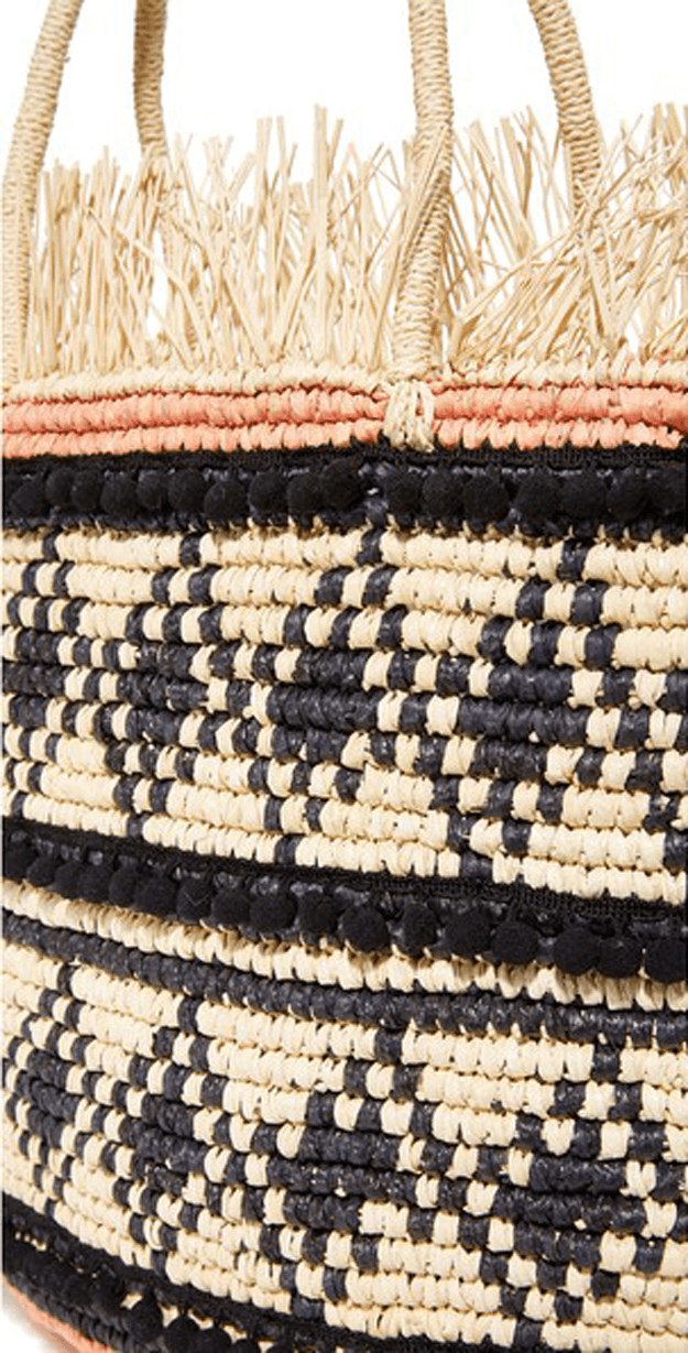 natural straw bag with black accents