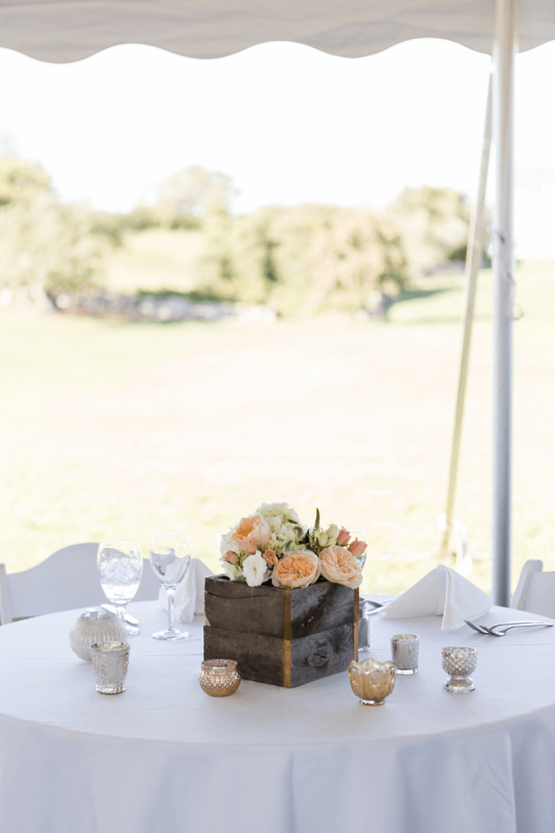 outdoor wedding with dark bronze wood centerpiece