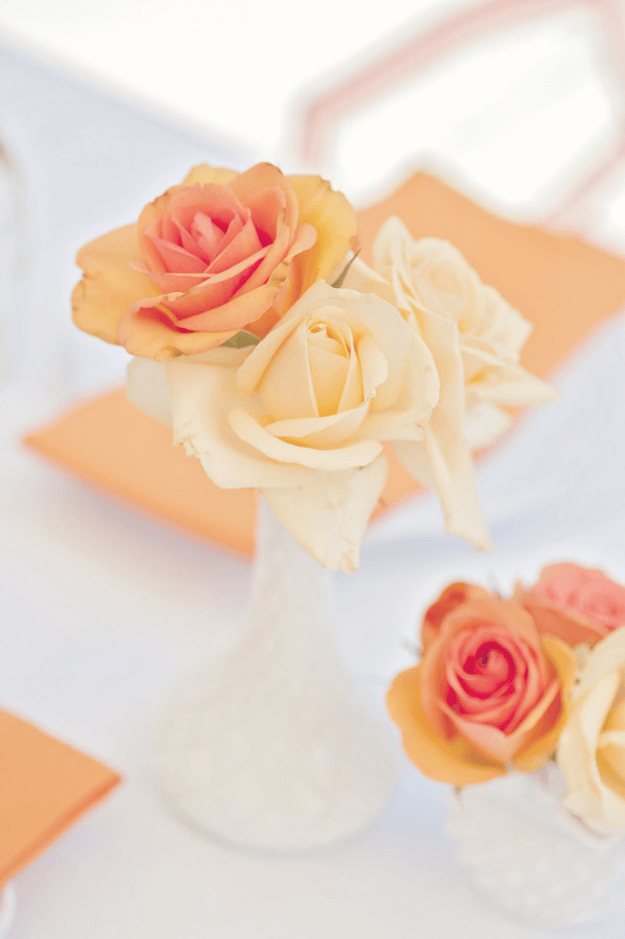 peach gold and tangerine table styling
