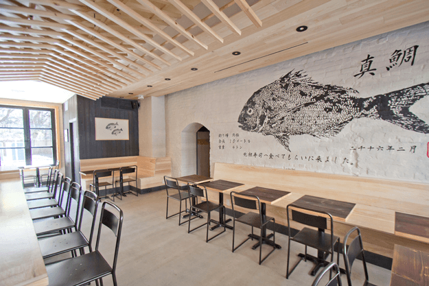 sushi restaurant interior with shou sugi ban accent walls