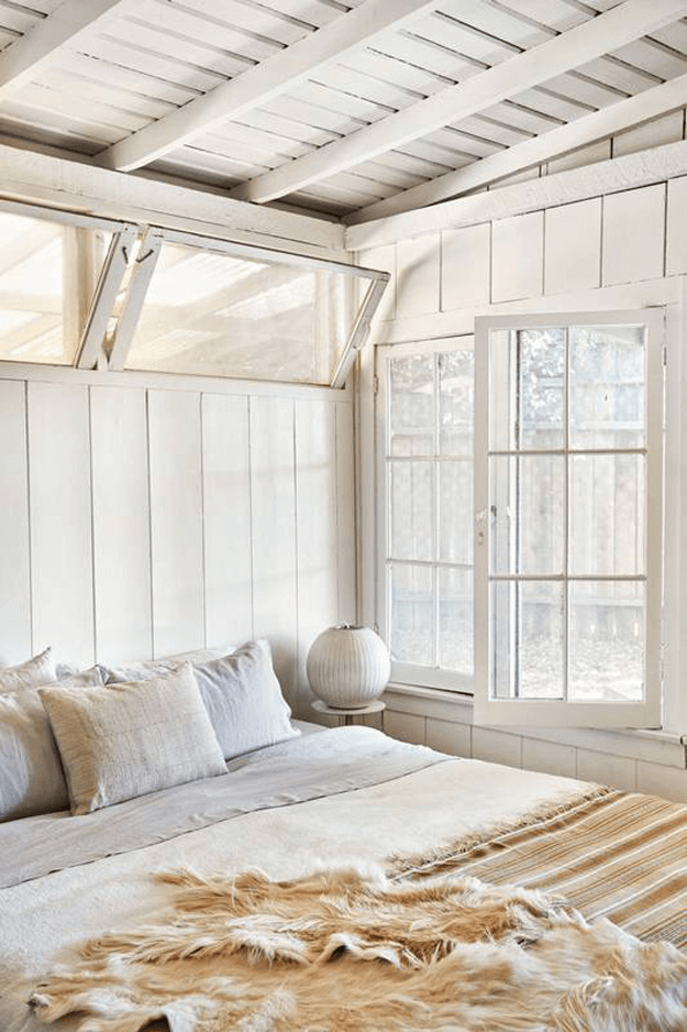 cottage style bedroom creamy white shiplap walls