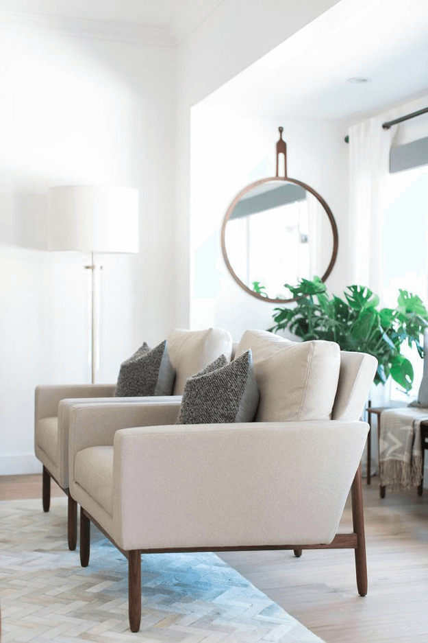 white living room with light taupe chairs