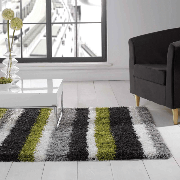 black and white living room with lime green stirped rug