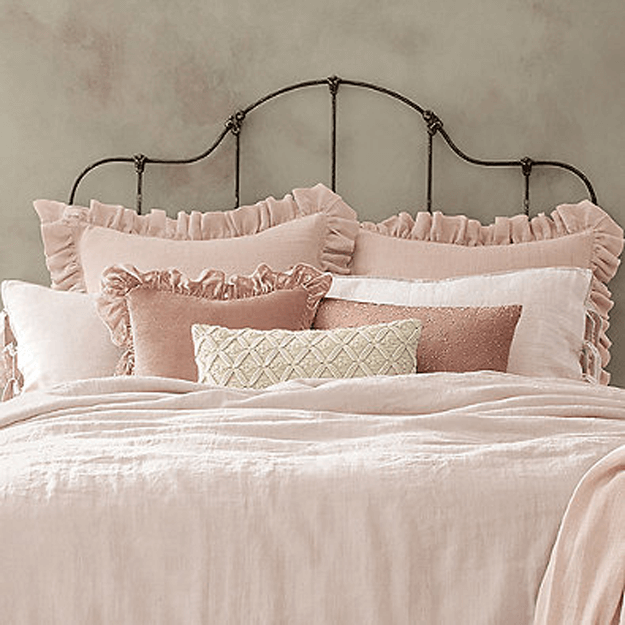 blush pink linen bedding in vintage style bedroom