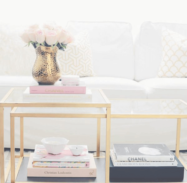 white sofa closeup with gold and pale pink accents