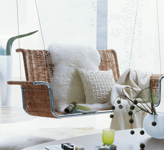 white sheepskin throw on rattan swing
