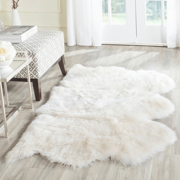 white sheepskin throw rug in ivory and gray room