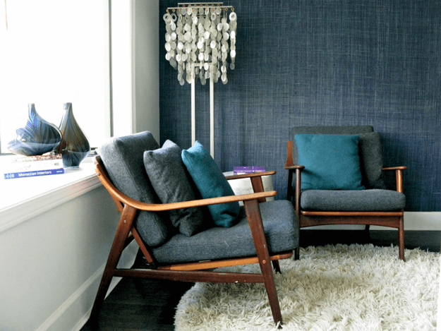 mid-century modern chairs with teal pillows